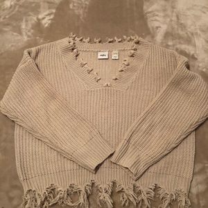 Woman's daytrip distressed sweater.